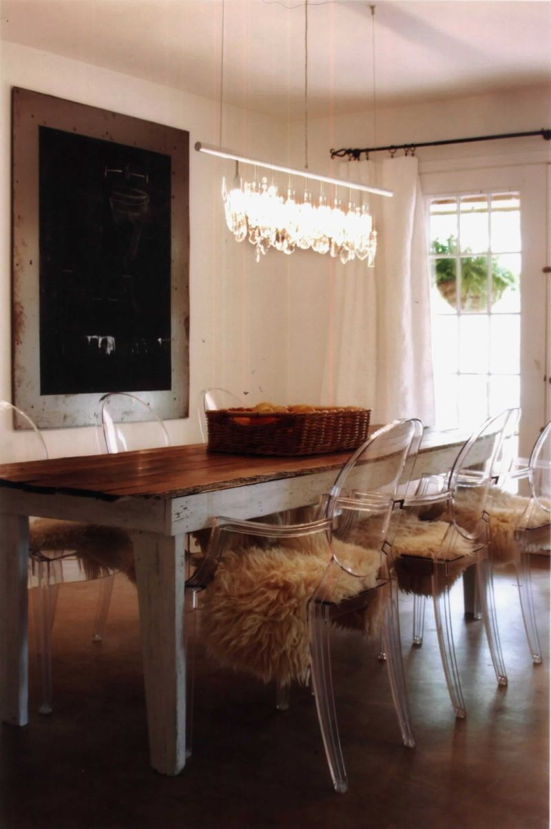 modern ghost chairs contrasting with rustic farm table in the dining