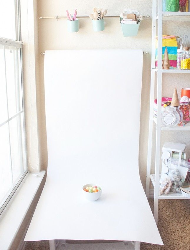 a roll of white paper makes for an easy backdrop photography from