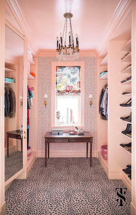Pink walkin closet features walls clad in pink geometric