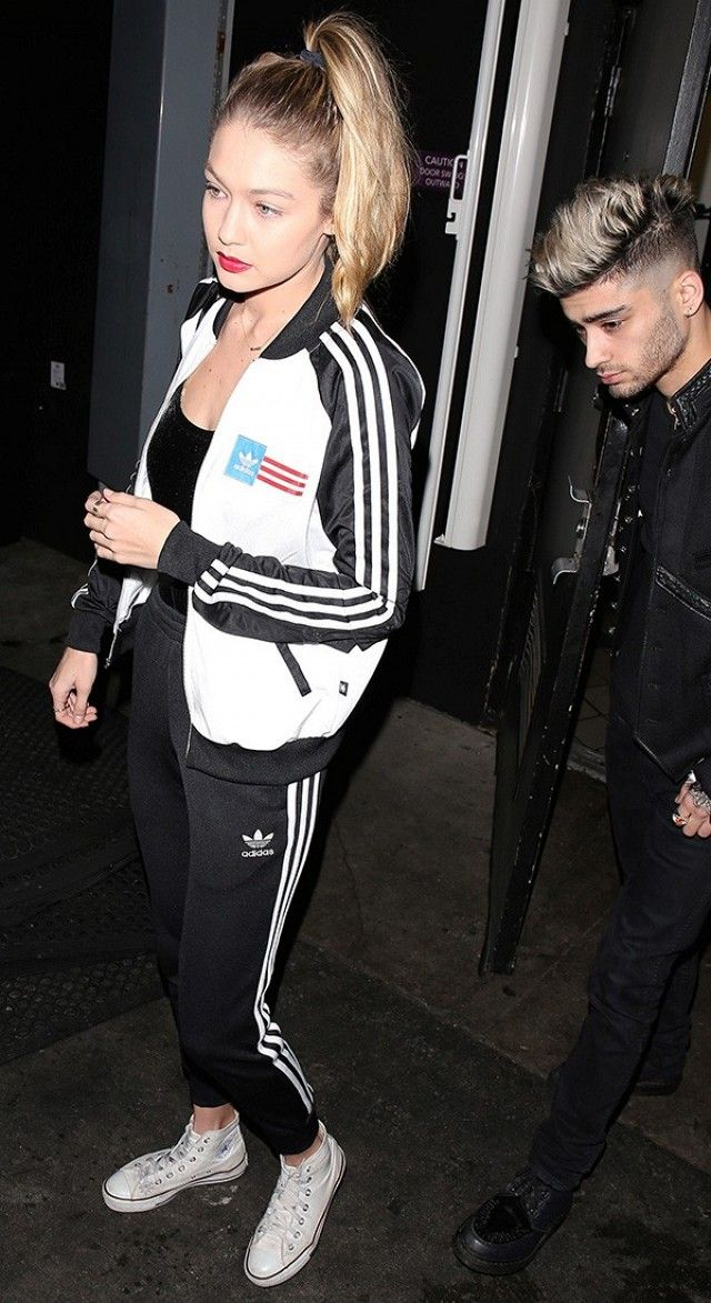 Gigi Hadid wears a bodysuit, Adidas tracksuit, and Converse sneakers