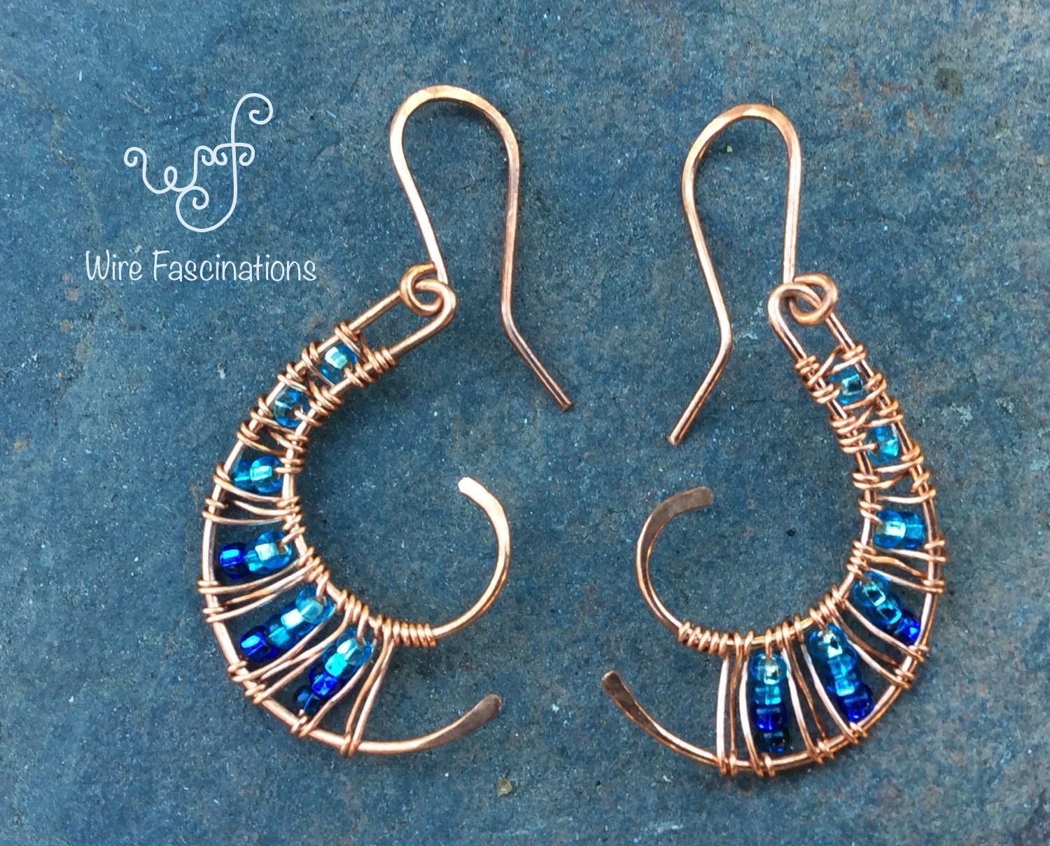 Handmade copper earrings nautilus curve with wire weave