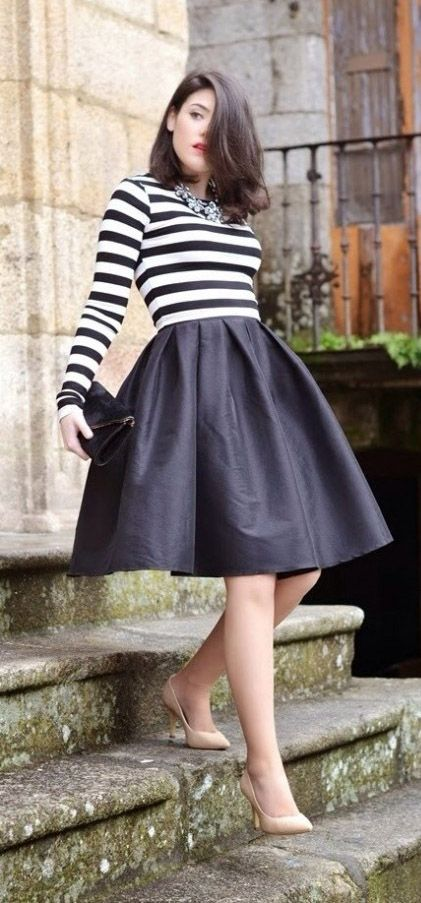 8bf3bdf247 Statement necklace, black and white striped shirt, black midi skirt, nude  heels, and black clutch