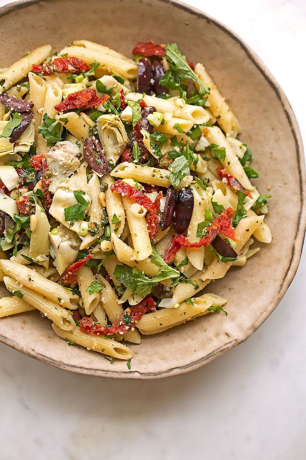 Mediterranean Pasta Salad - This Cafe Express inspired pasta salad is loaded with marinated artichoke hearts, sun-dried tomatoes, kalamata olives, and so much more!  