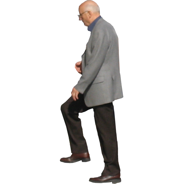 A bald man ascends a staircase.