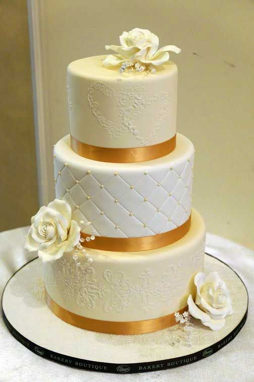 Gold ribbon ivory flowers wedding cake on Equally Wed Duet