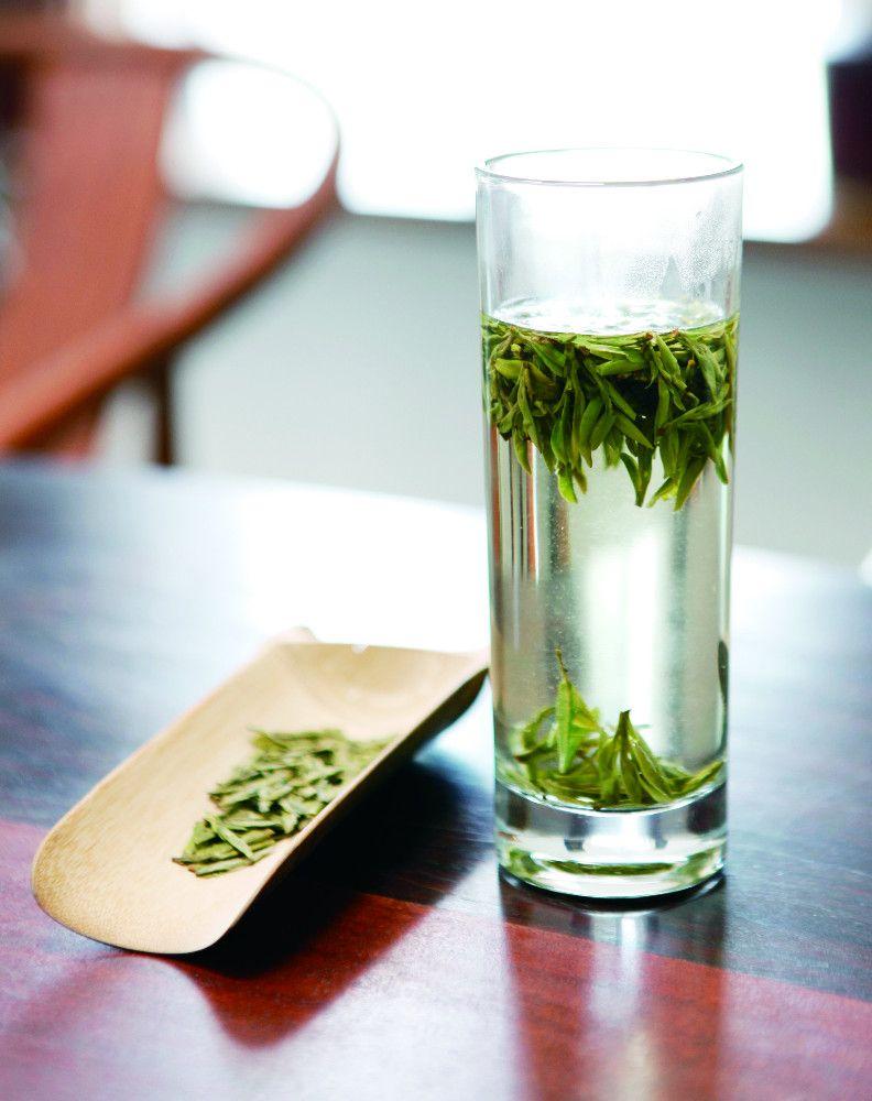 Glass of longjing tea. Chinese tea set, Longjing tea