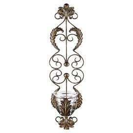 "Wall sconce with fleur-de-lis accents and a scrolling garland motif.  Product: SconceConstruction Material: Metal and glassColor: BronzeAccommodates: (1) Candle - not includedDimensions: 36.75"" H x 8.25"" W x 7"" D"