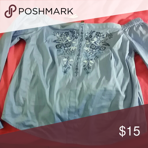Express blue blouse It hangs over the shoulders and has a floral print on the chest Express Tops Blouses