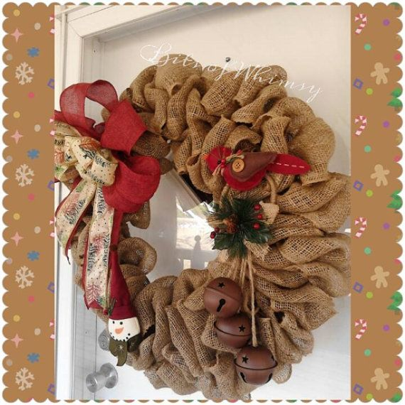 This burlap wreath measures approx. 33 inches across, complete with bow, bells, bird and soft snowman. Wreath is made on wire form.    All