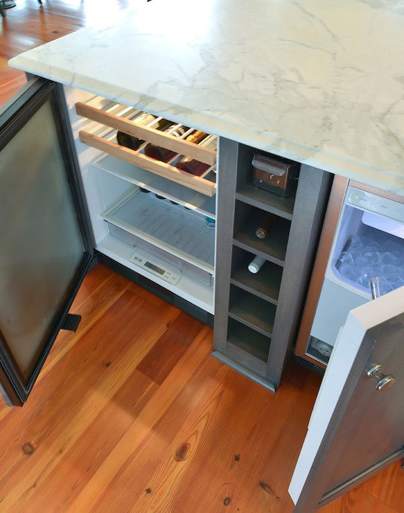 Gorgeous Kitchen Island With Wine Cubbies Flanked By