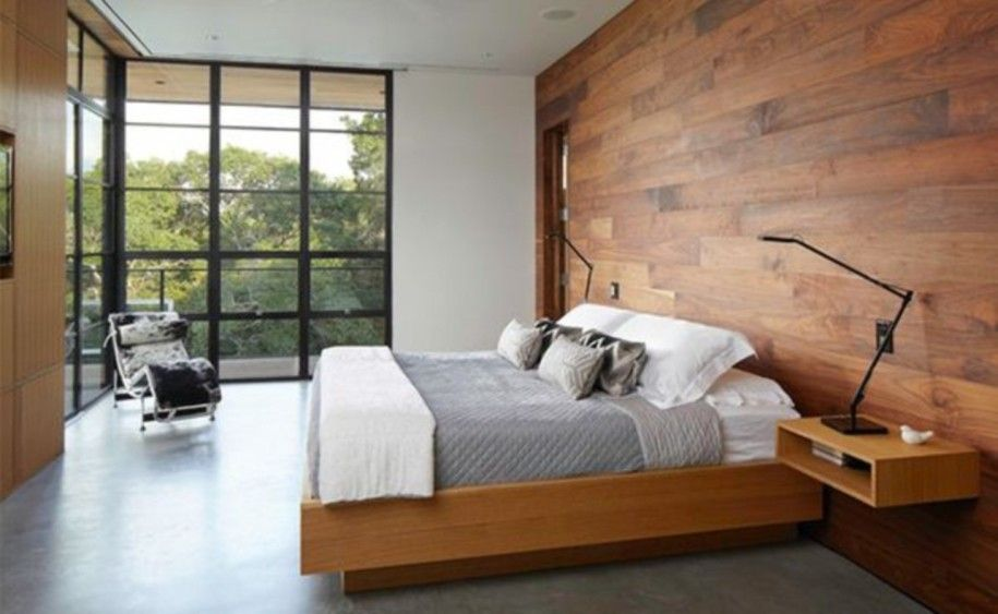 Simple Bedroom With Wooden Panels On One Side