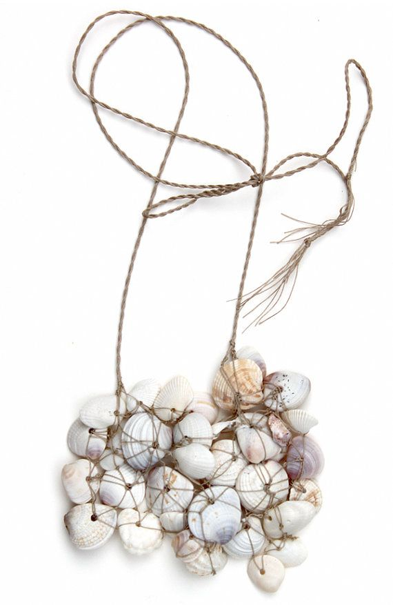 Nautical Seashell Necklace is made from seashells found on the shores of Florida's Sanabel Island. Holes in seashells are naturally carved by predatory snail called Moon Snail.
