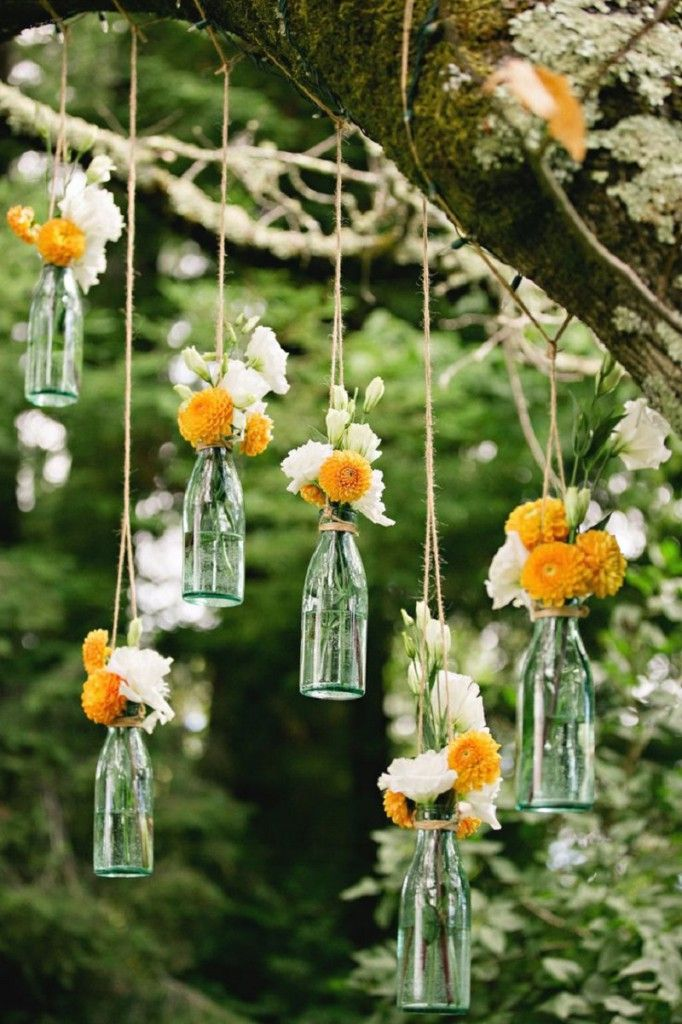 Lovely Colorful Hanging Bottle And Flower Garland Ideas For Pursuing Fabulous Outside Wed Garden Party Decorations Garden Wedding Decorations Romantic Backyard