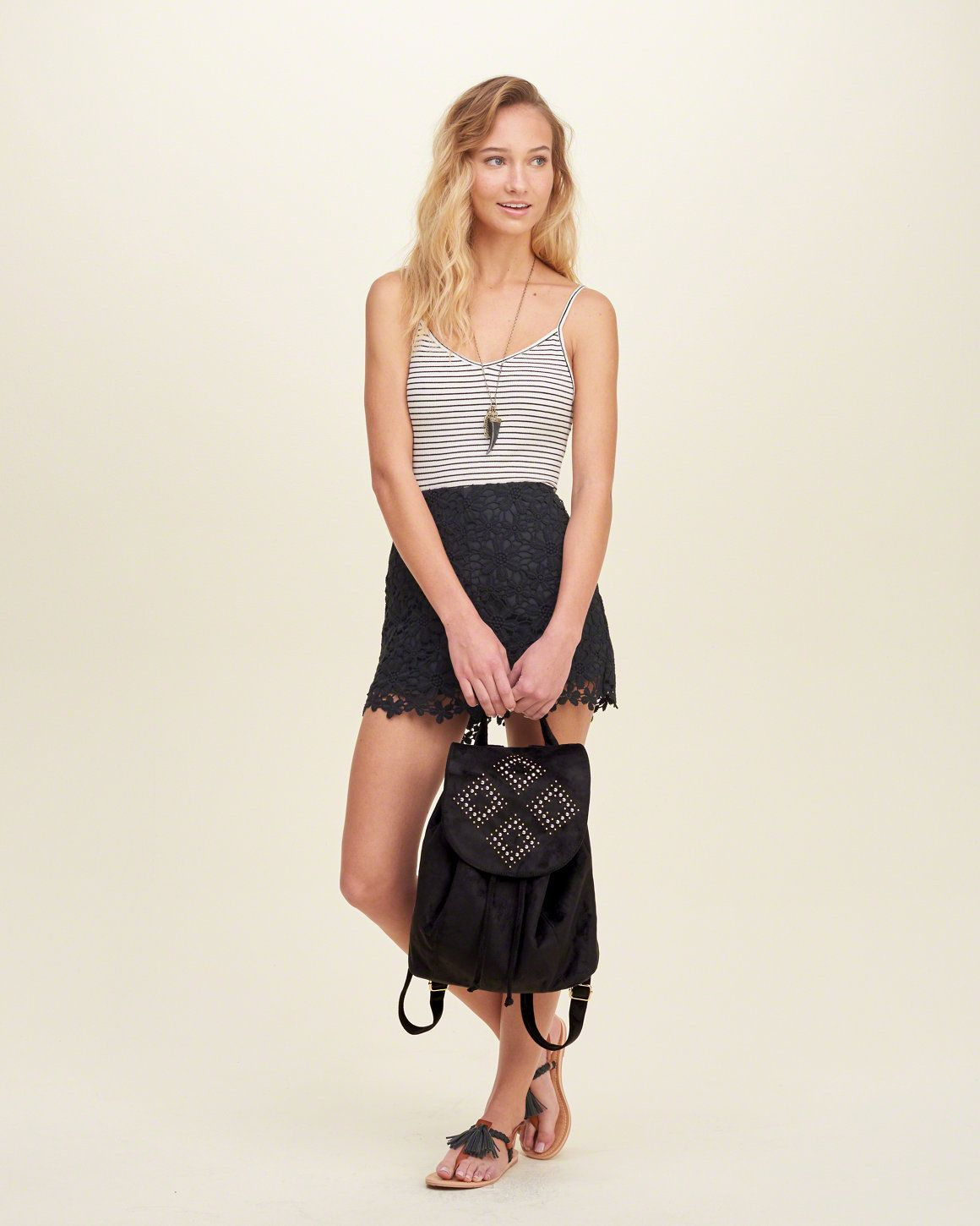 Get ready for any adventure with this edgy carryall, featuring a flap closure, interior drawstring closure, decorative details, adjustable shoulder straps and a handle.