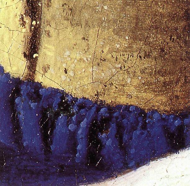 « Pointillés » jaunes et bleus sur un détail des habits de La Laitière de Vermeer
