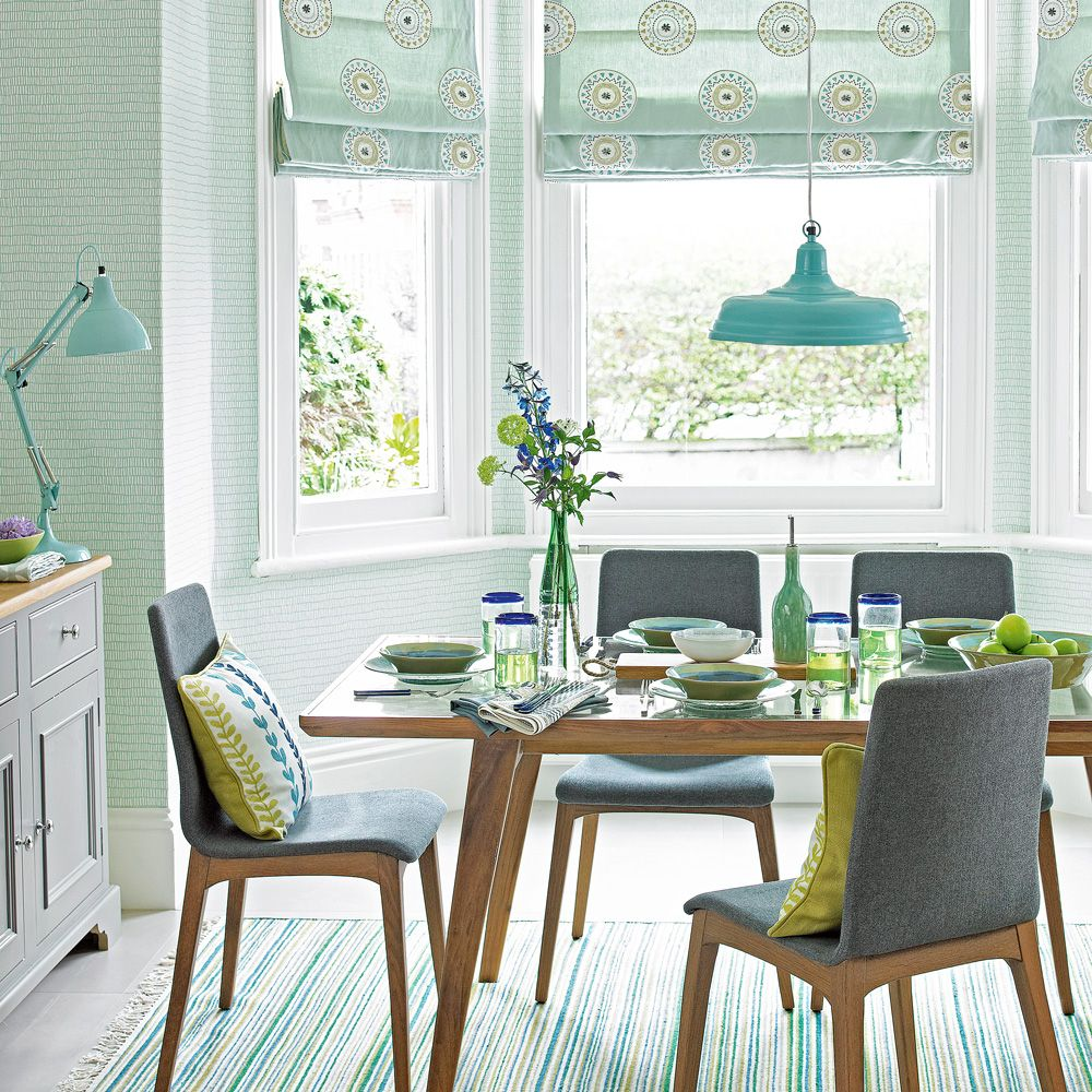 Mint Green Dining Room With Mid Century Style Furniture And Pendant Light