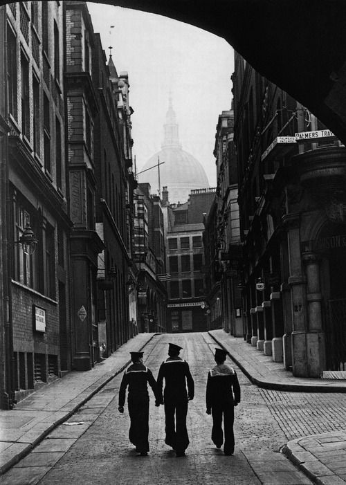 sailors heading up peter's hill from the river towards the dome of st paul's cathedral looming above the rooftops, 1938    photographer unknown, from london. portrait of a city