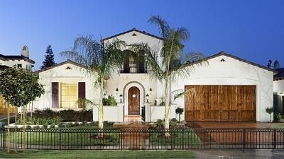 White Stucco Homes spanish colonial details like white stucco and stained oak doors