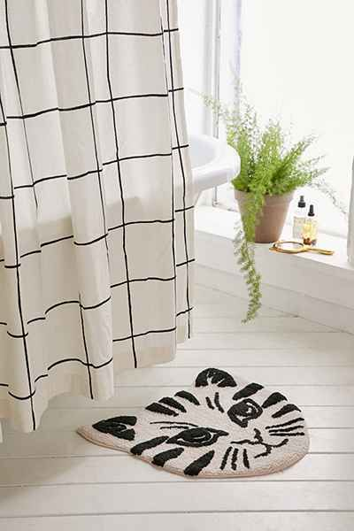 Fun bath mat crafted from soft tufted cotton + topped with a cat face graphic. Great for a quick update to your bathroom.
