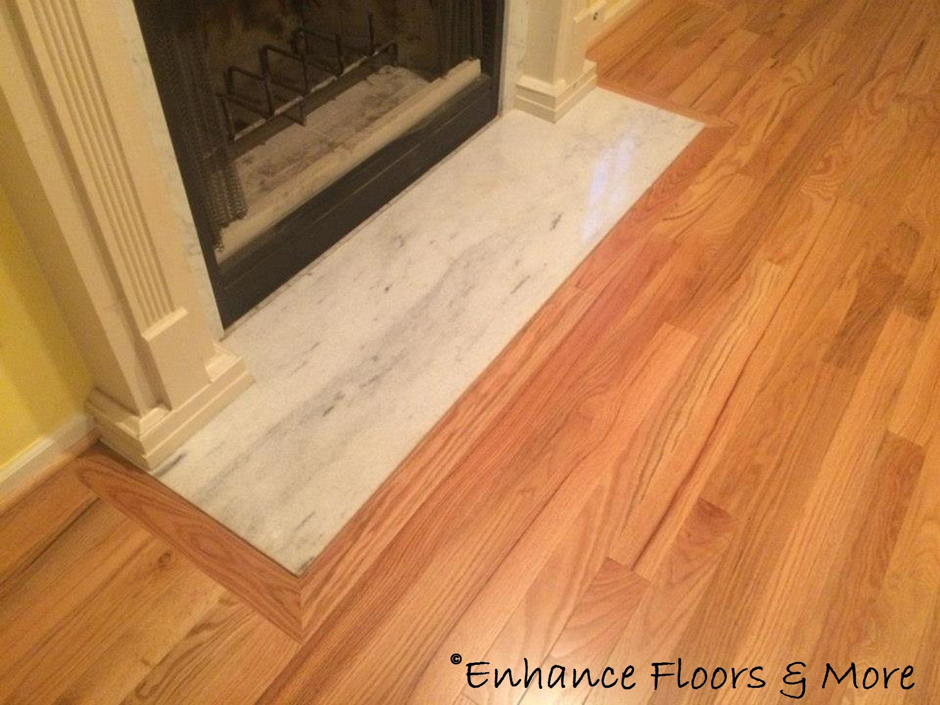 Picture framing around the fireplace Hardwood floors