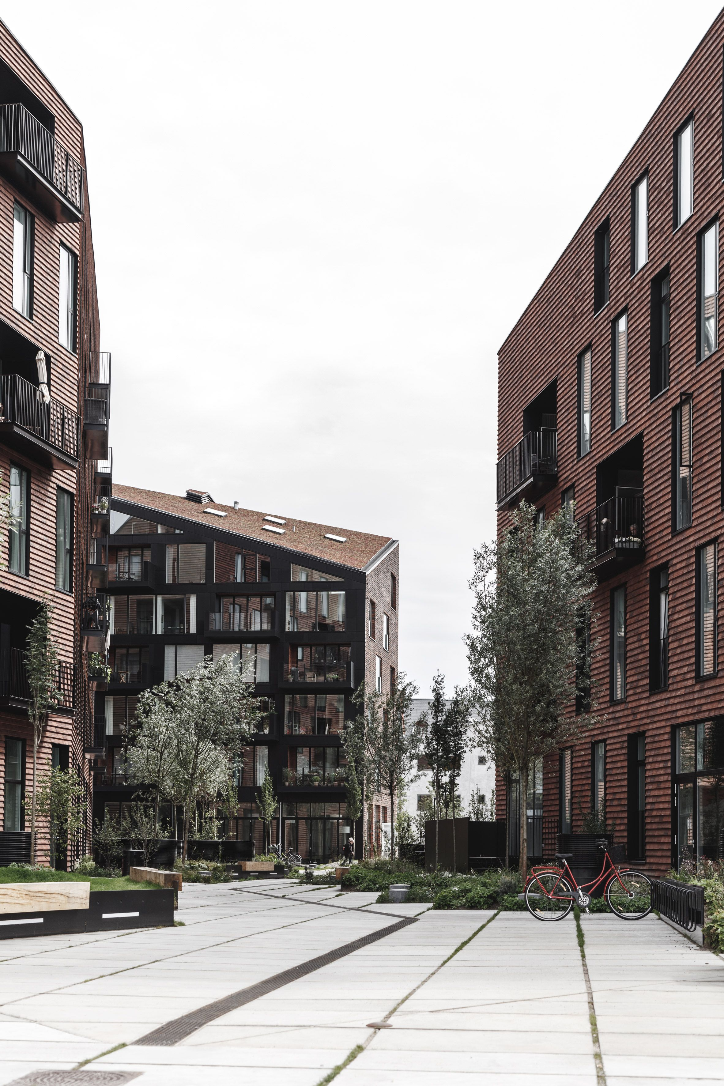 The faceted roofline and brick surfaces of these apartment blocks by COBE and Vilhelm Lauritzen Architects take cues from warehouses on Copenhagen harbour