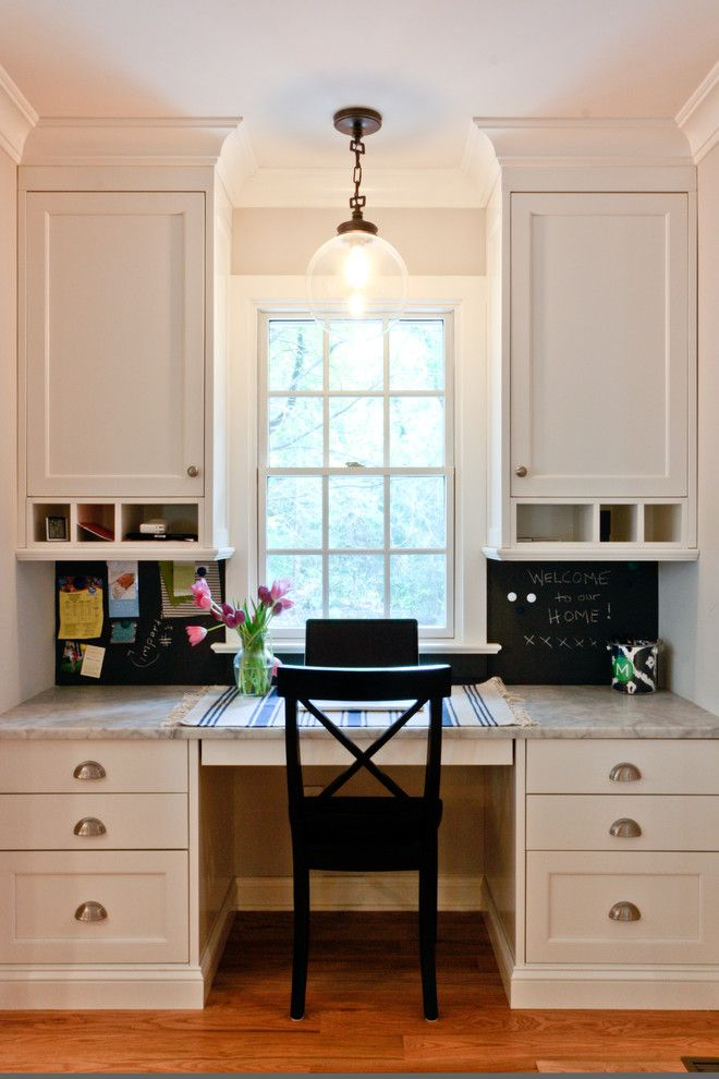 Built-in desk has lots of drawers and cupboards and shelves. I really like this concept.