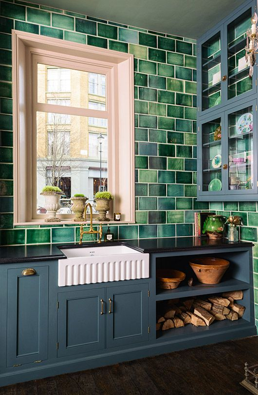 Beautiful green subway tile with farm sink and brass faucet. Devol's showroom in London.