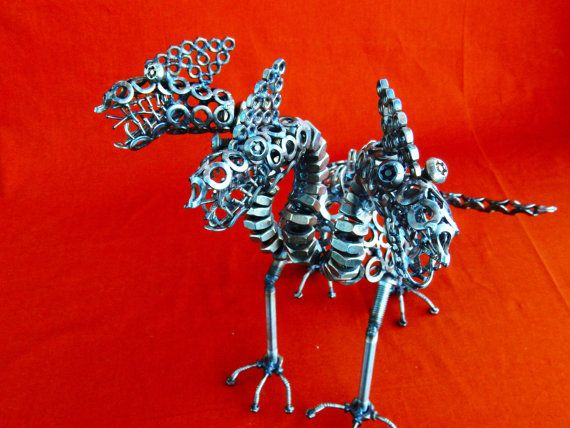 scultura cerbero in acciaio misure  30 cm per 30 di stevieacciaio