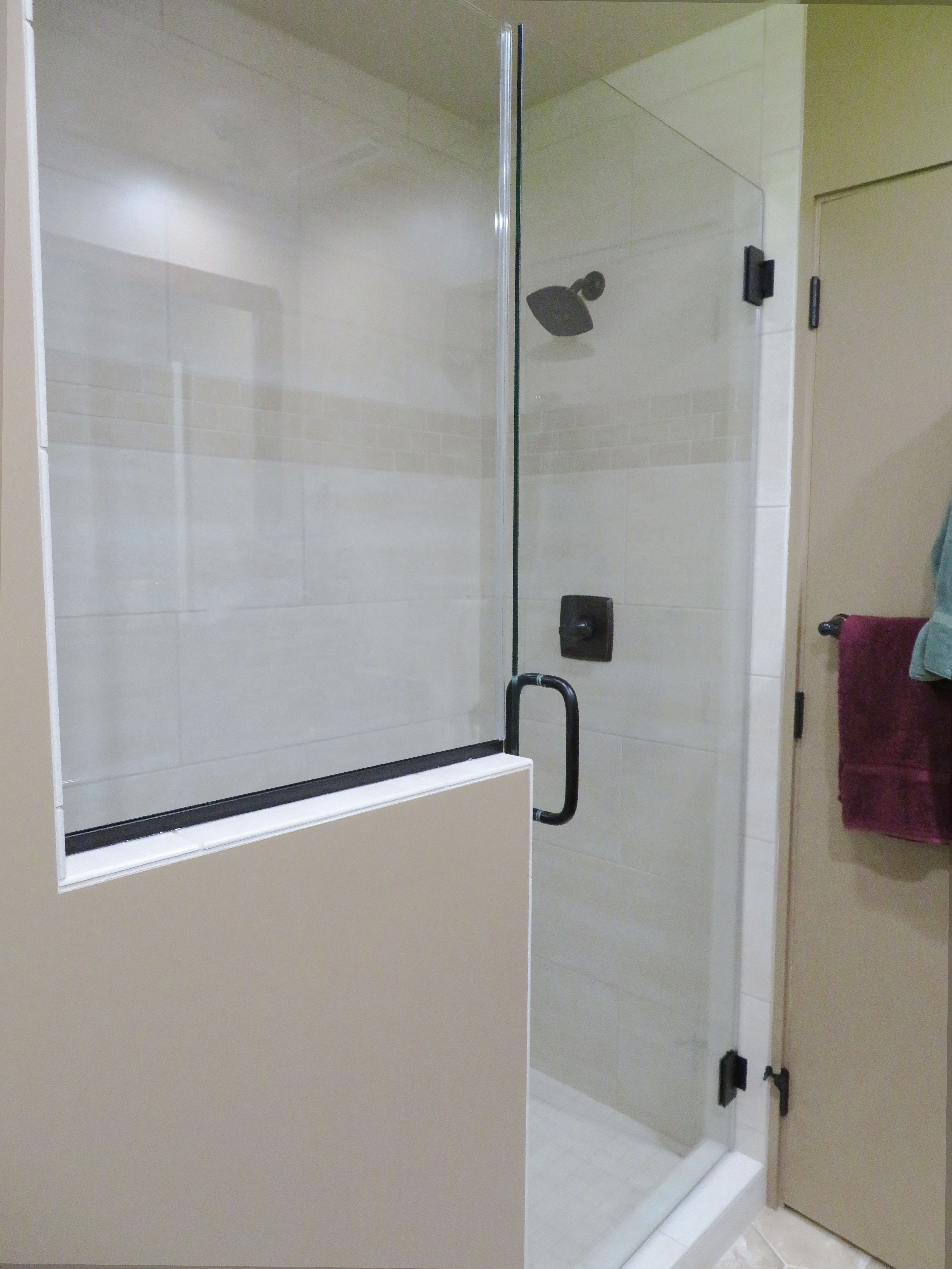 Tile Shower With Gl Doors Niche Behind The Half Wall To Keep Clutter Of Shampoo Tucked Away And Out Sight