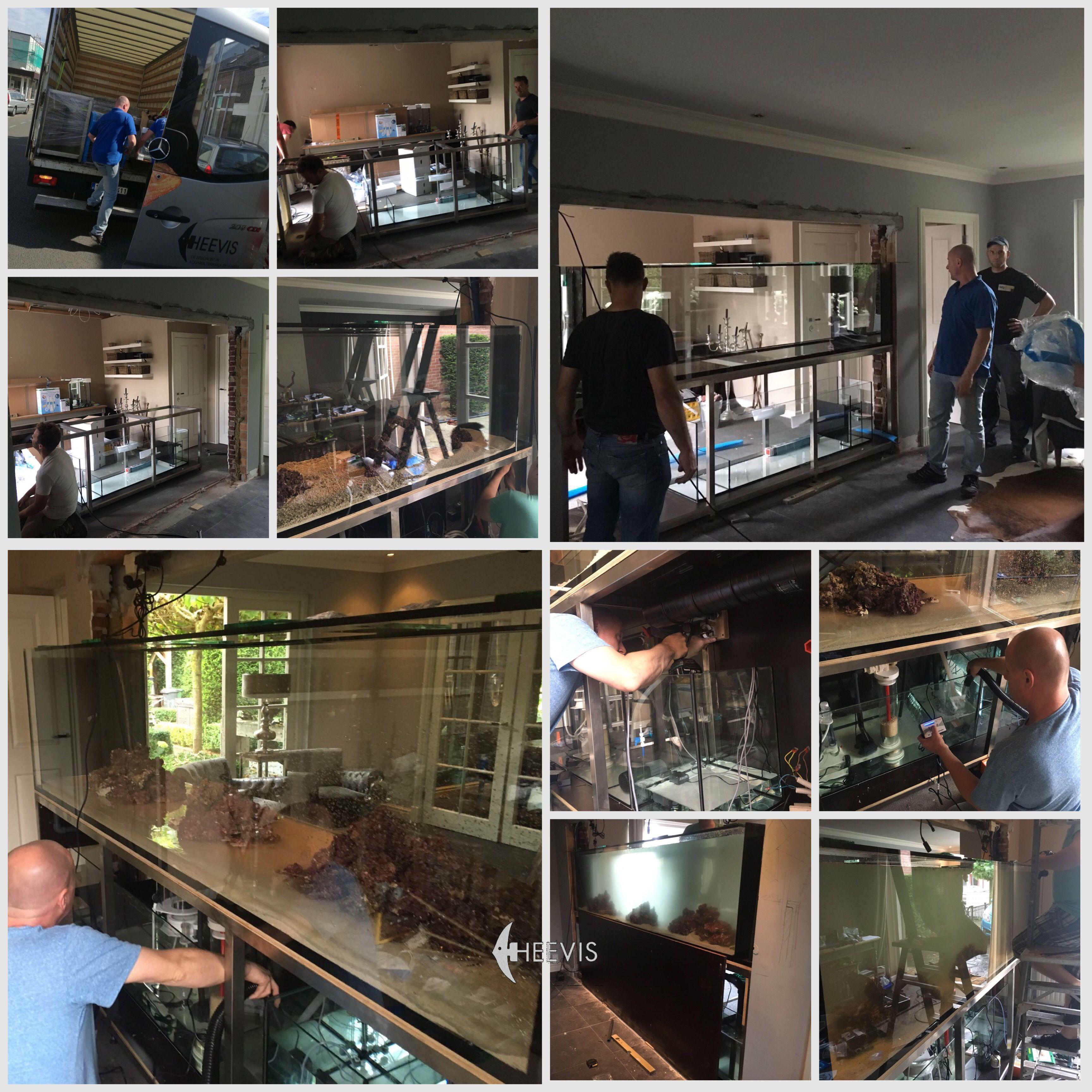 Jos en helpers bezig met een groot inbouw Heevis zeeaquarium van 284 x 60 x 70h cm. Compleet computergestuurd. Alles wordt weggewerkt en de muur wordt opnieuw om het aquarium gebouwd. Direct alleen het doorkijk aquarium nog zichtbaar.