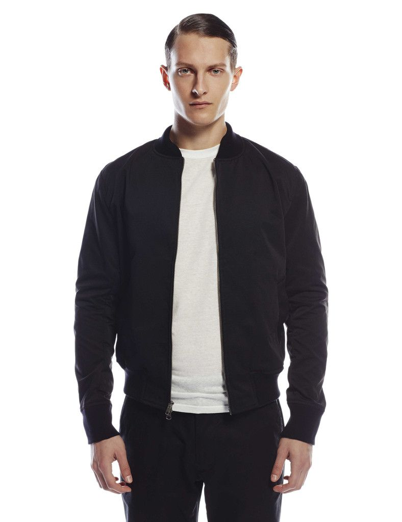 Aviator Jacket - Black Grosgrain - The CADET interpretation of the classic bomber jacket in structured grosgrain technical fabric. Custom knit rib on the neck, sleeve cuff and waist that was made specifically for us in Minnesota. Two-way brass YKK zipper with two internal and two welt pockets. Unlined. - 100% Polyester. - Made in New York.