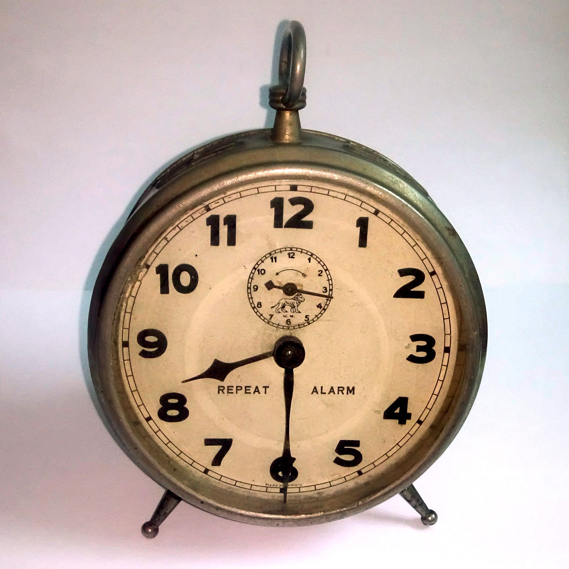 Antique alarm clock made in Germany about 1910-1930. Has a ...