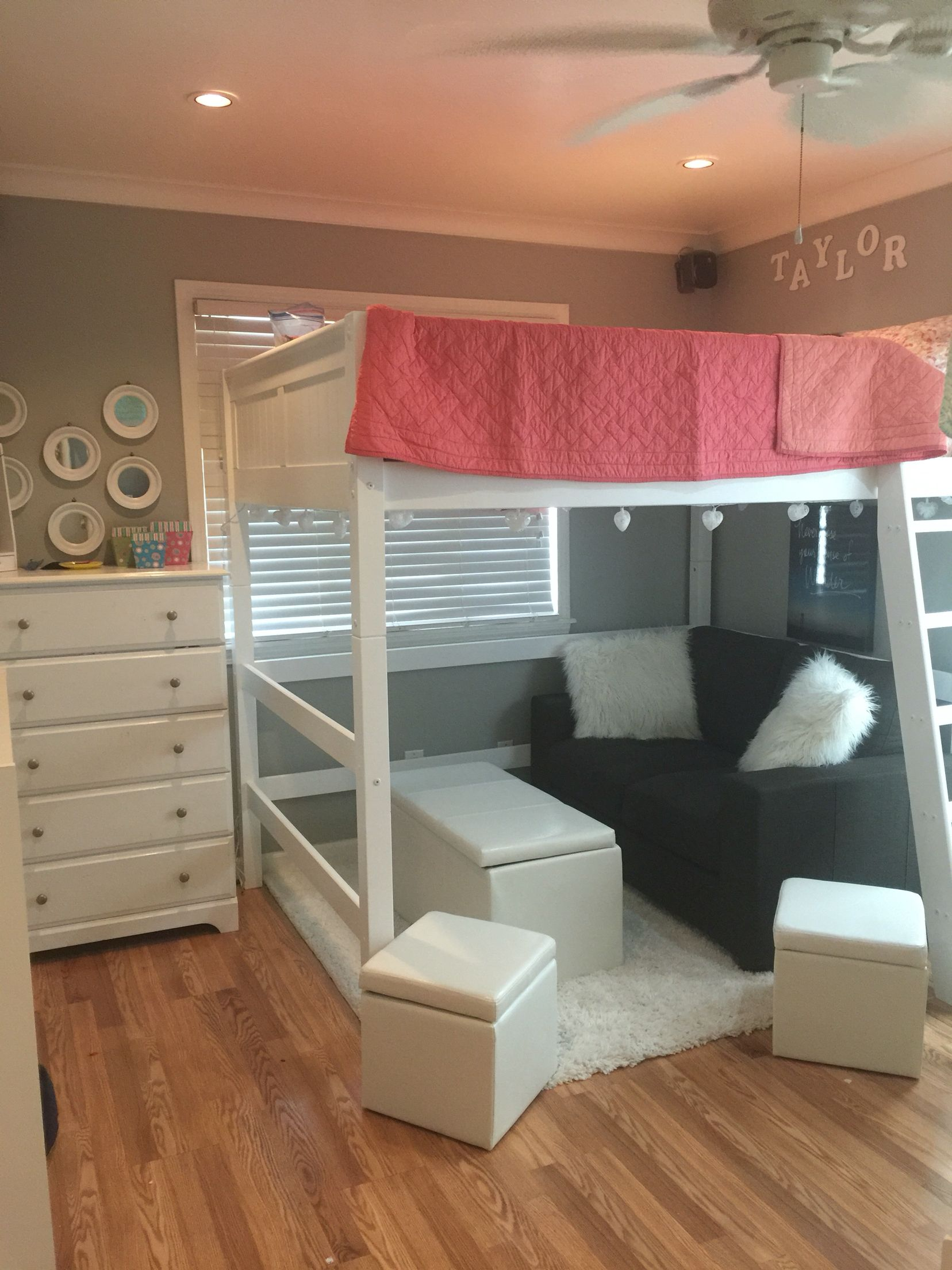 full sized loft bed with seating area