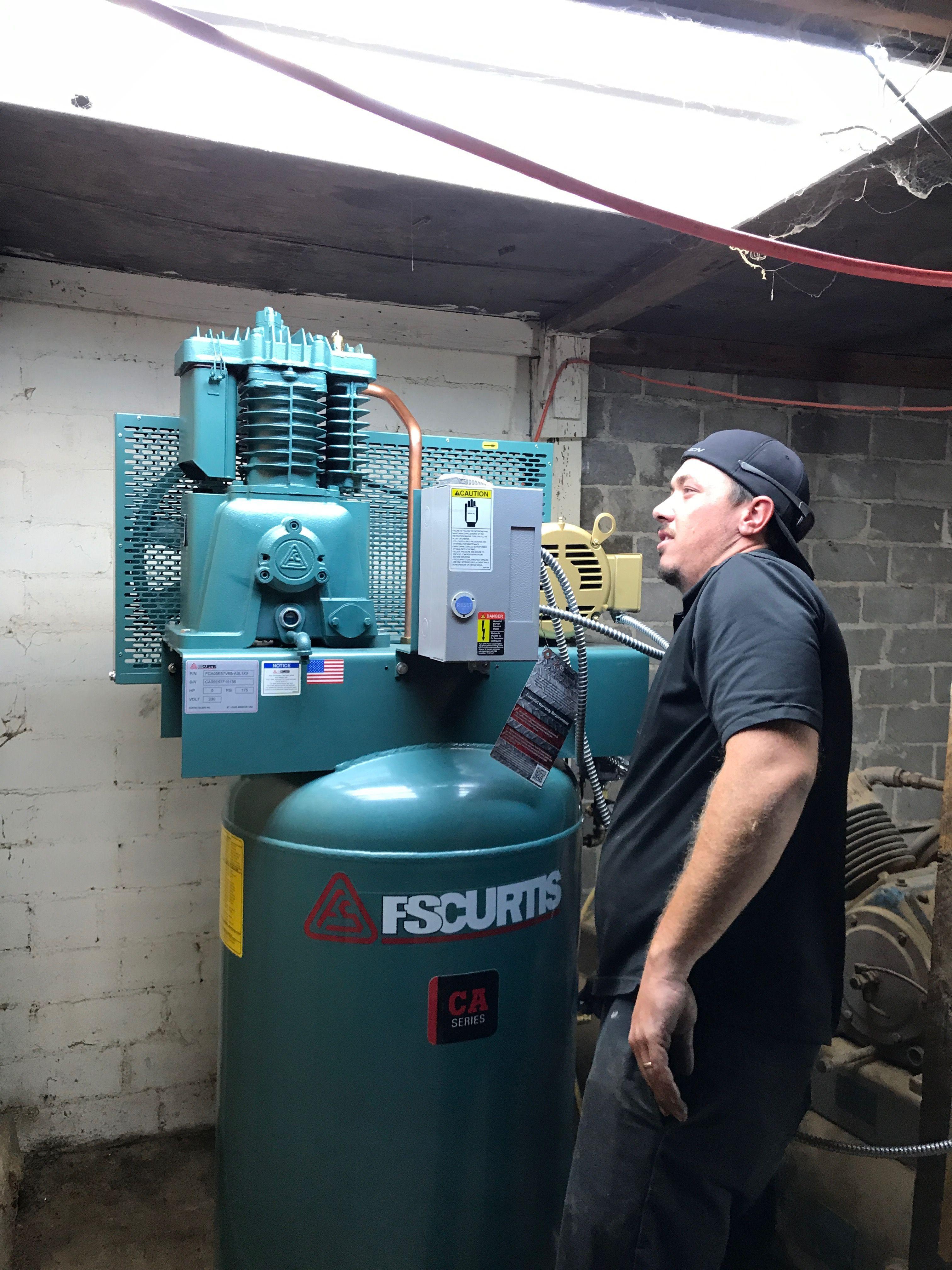 My technician installing a new piston compressor. maaco