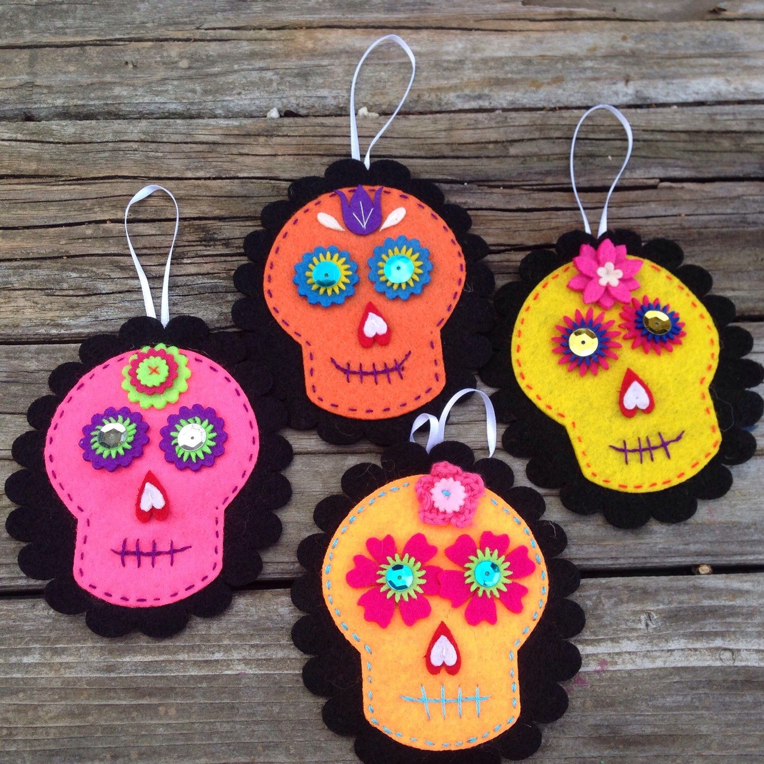 A personal favorite from my Etsy shop https://www.etsy.com/listing/264427712/muertos-ornament-decoration