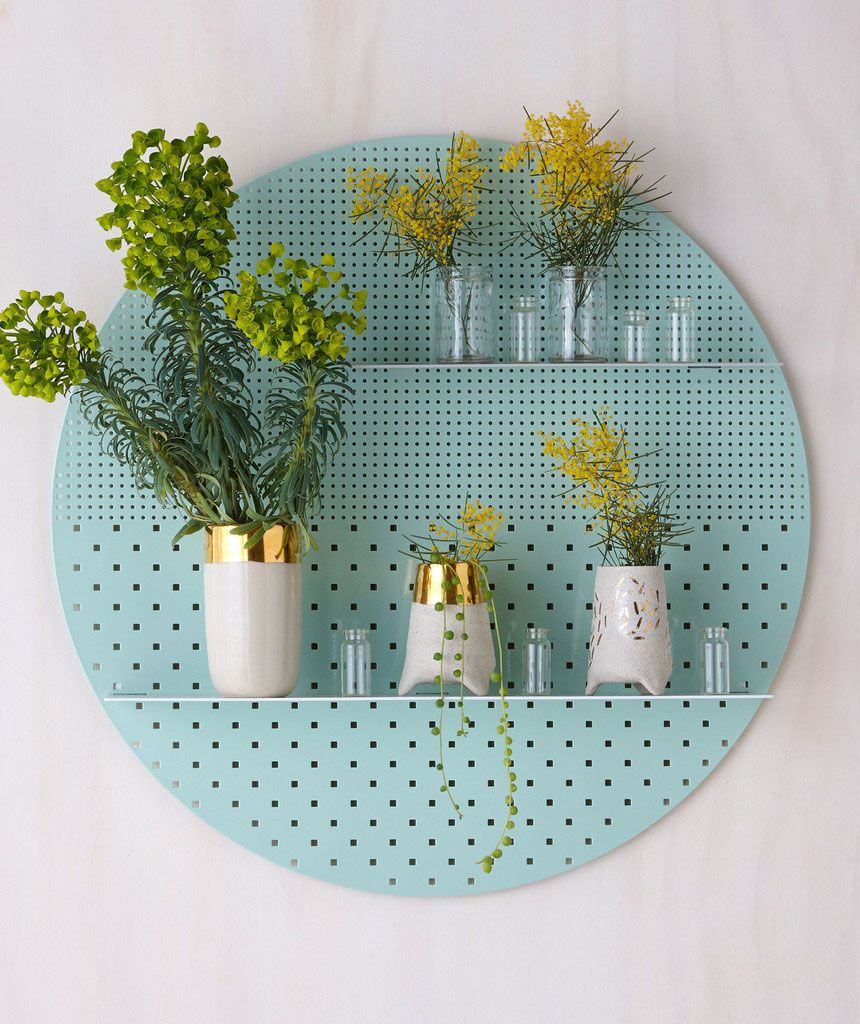 THE MESH SERIES Perforated metal provides the backdrop for the shelf arrangement ; contemporary colour palettes and patterns create a frame to display ornaments, vessels, plants, and personal object