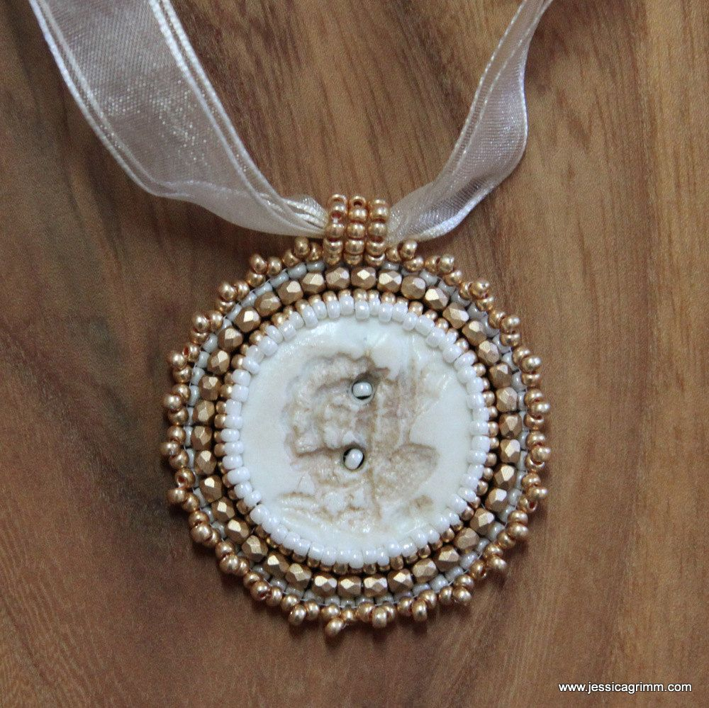 Hand-embroidered gold and cream Pendant with ceramic button and pearls von JessicaMGrimm auf Etsy