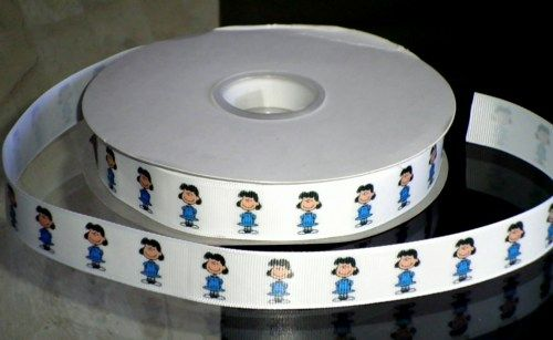"This listing is for 2 continuous yards of 7/8"" wide white double faced satin/grosgrain ribbon (your choose, just memo which type you'd prefer when checking out)  with Lucy from Peanuts printed on it."