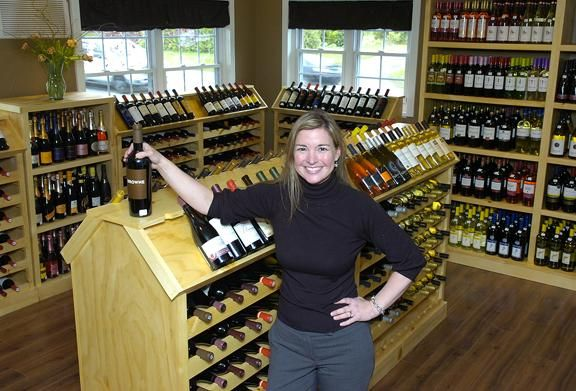 Melissa Brumley of Saratoga Wine \ Spirits displays one of her - courtesy clerk