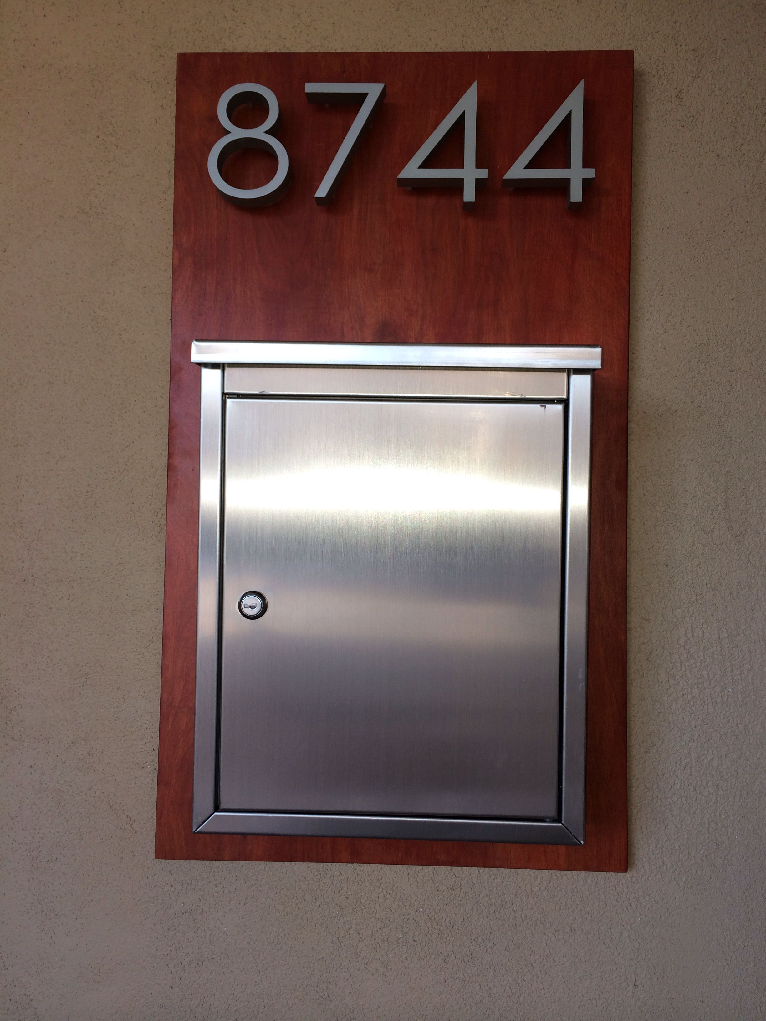 I built this wall mounted mailbox and address panel with modern mailbox and neutra numbers