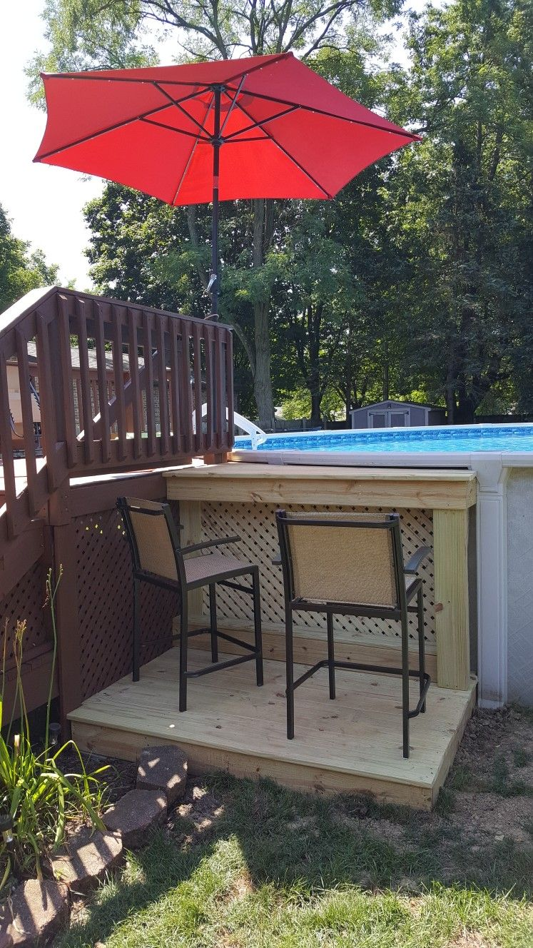 The Umbrella Was Purchased At Meijer And Features Solar Powered Leds At Night It Really Liven Backyard Pool Landscaping Above Ground Pool Landscaping Backyard