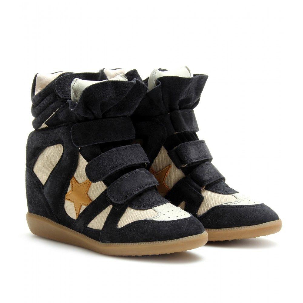 Une icône street-style essentiel: Nous aimons Isabel Marant sneakers noir  soufflé coin suède
