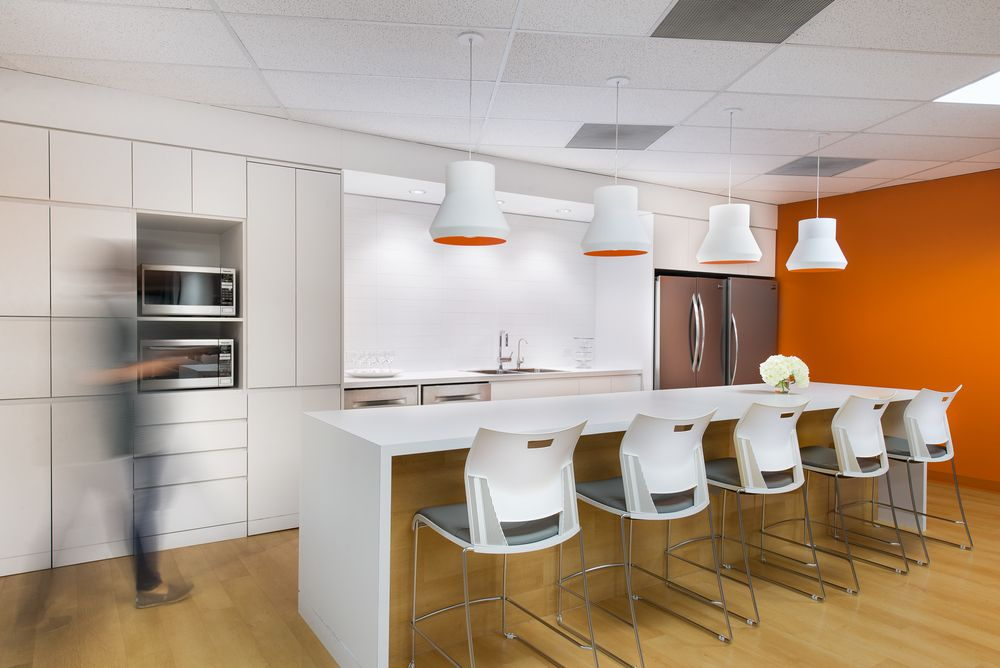 White Kitchen Orange Accents staff kitchen at t2 digital - office interior designssdg