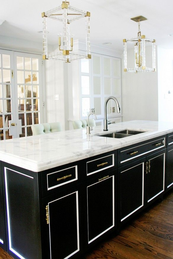 A Dated Kitchen Gets Stunning Modern Makeover Black Island Lucite Pendants French Doors Mirrored Cabinets