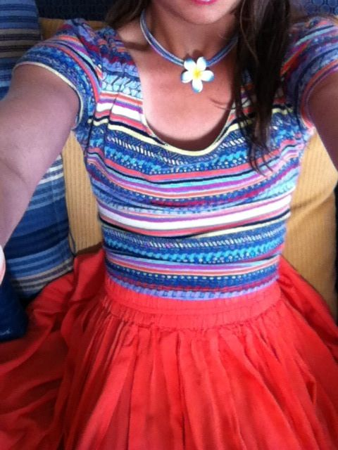 Bought the shirt at Delia's and the skirt at aeropastle wearing a flower necklace and orange glasses