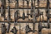 USA Alaska Collection of old traps hang on log cabin wall Premium Photographicalaska