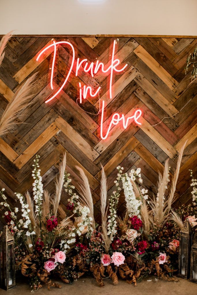 Photo of Neon sign at a vegan and bohemian Byron Bay wedding photographed by Lily Red Creative – Australian W