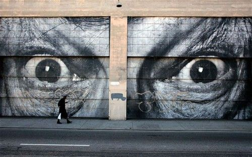 I ALWAYS FEEL LIKE…  A man walks past the outside wall of the 'Art In The Streets' exhibit at the Geffen Contemporary at the Museum of Contemporary Art in Los Angeles.  (Photo: Reuters via the Telegraph)