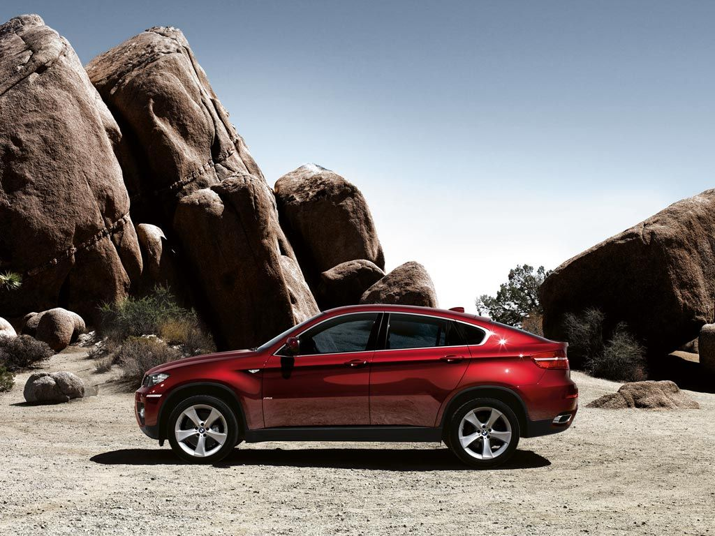 Bmw X6 This Car Epitomizes The Goal Of The So Called Crossover An Suv With Car Character This Side View Of The Gnarly X6 Bmw X6 Car Wallpapers Bmw Cars
