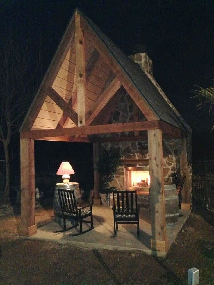 New definition for curling up by the fire with a good book Outdoor room with fireplace
